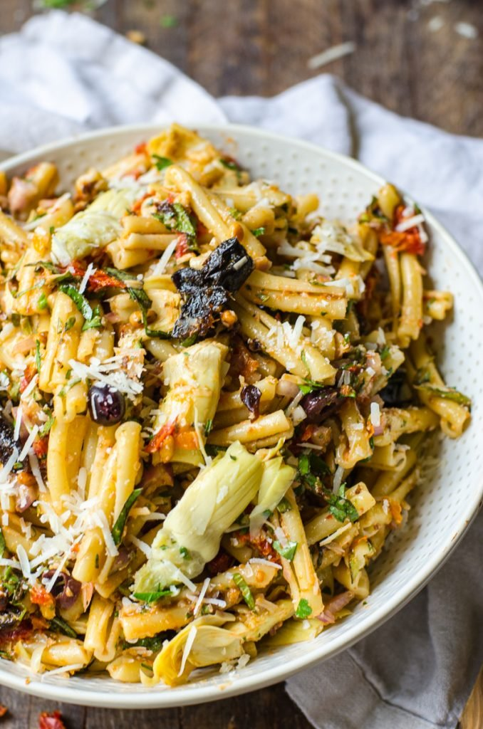 A bowl of sun dried tomato pasta salad with California Prunes.