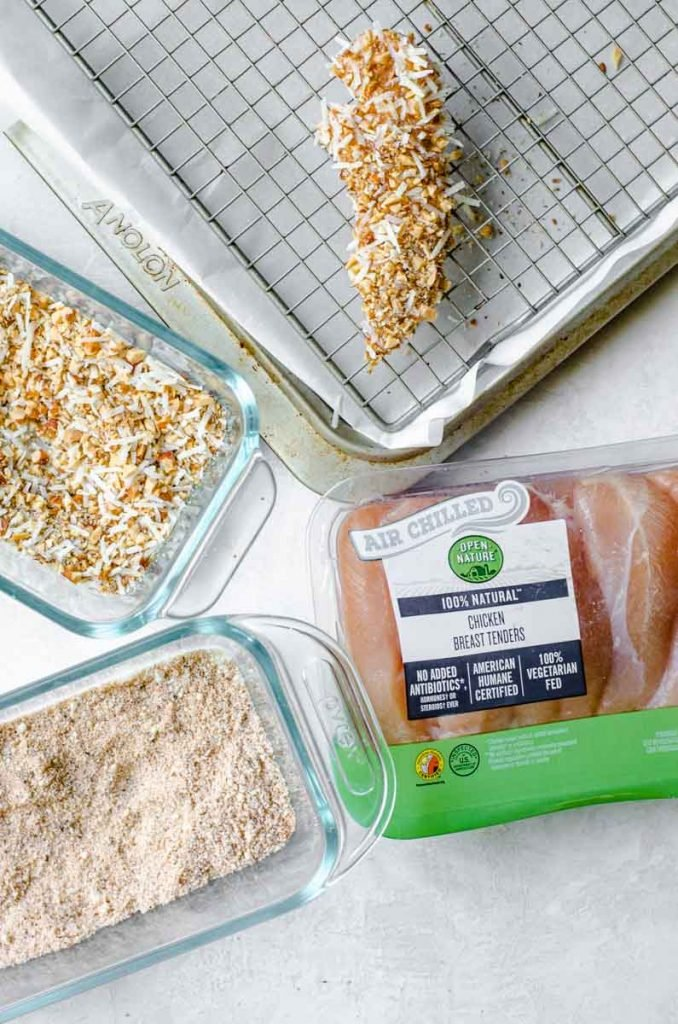 A package of air chilled chicken tenders next to the ingredients for making almond crusted chicken.