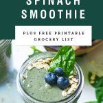 A green blueberry spinach smoothie with title text on a green background.