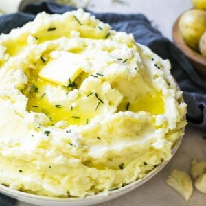 A butter pat melting on top of goat cheese mashed potatoes.