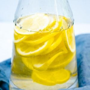 Close up of lemons in a pitcher.