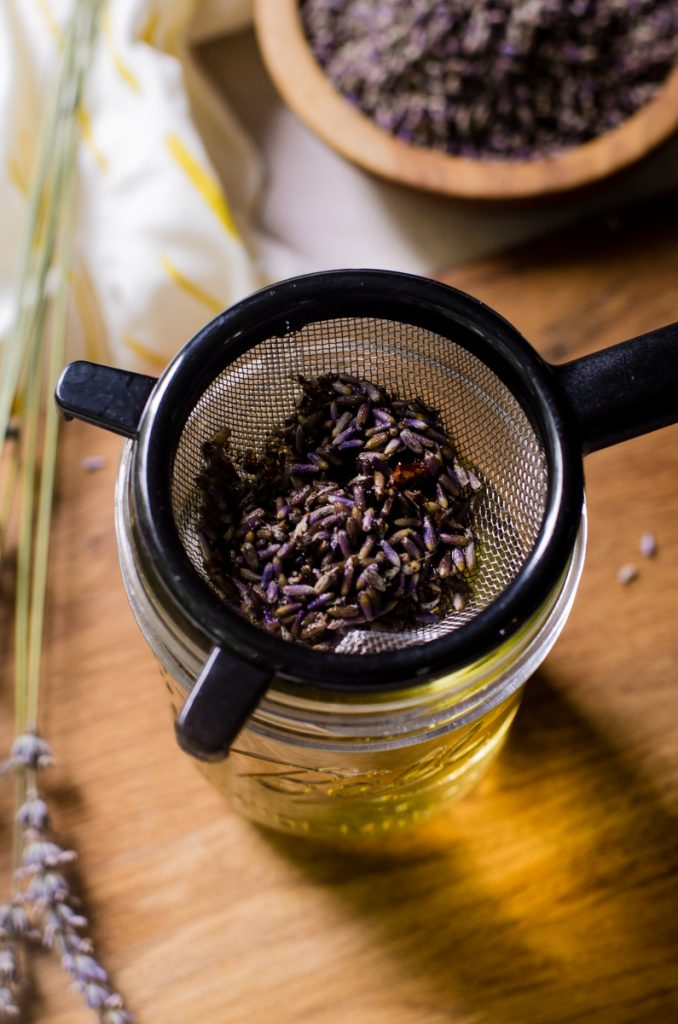 A fine mesh strainer filled with dried lavender.