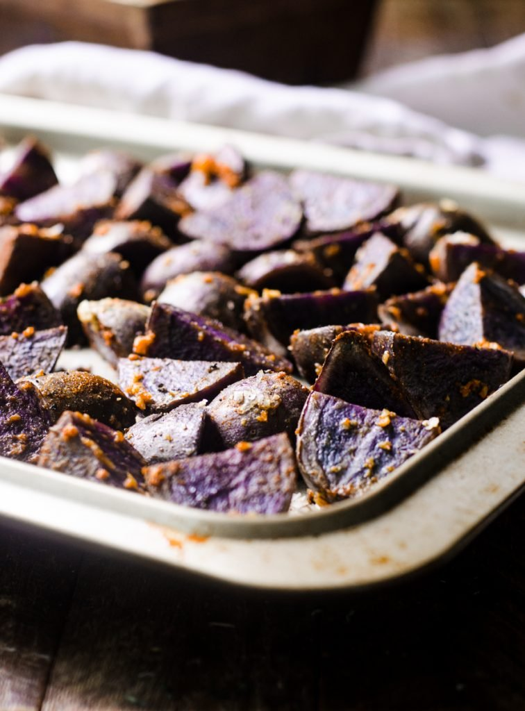 A sheet pan of cooked roasted potatoes.
