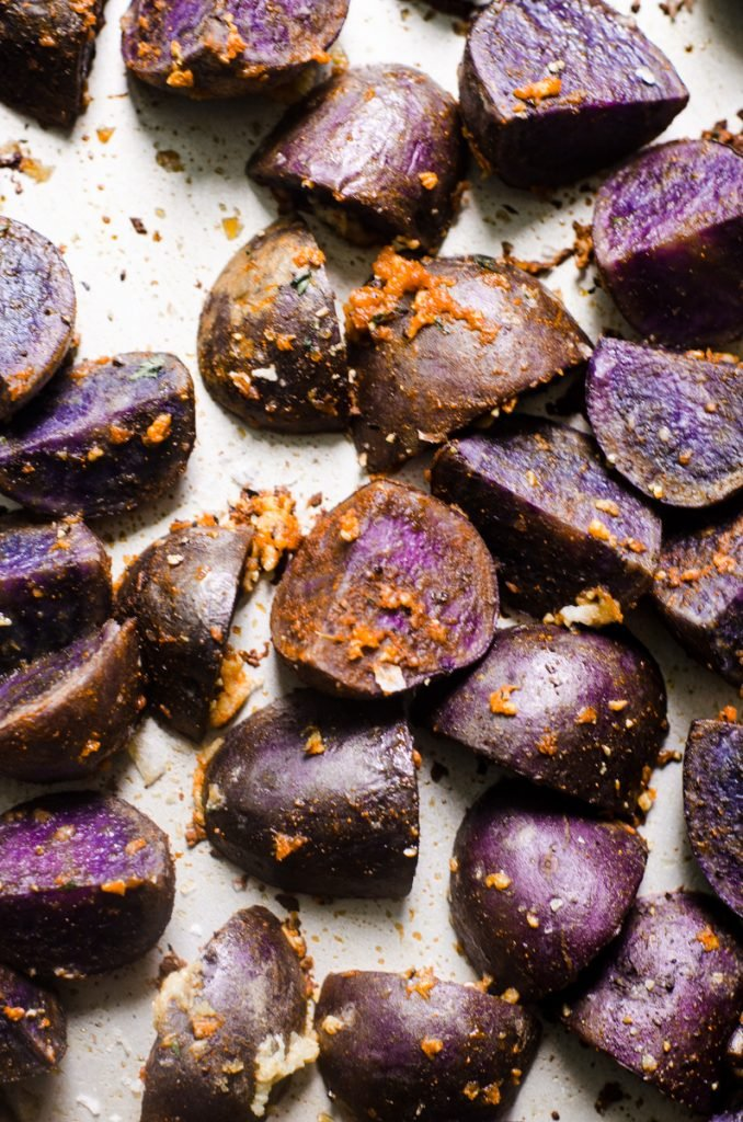 Cooked purple potatoes with garlic.