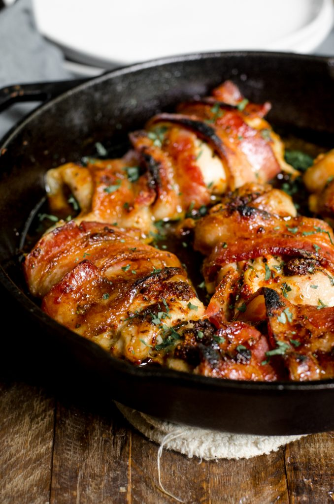 Cooked bacon wrapped chicken thighs in cast iron.