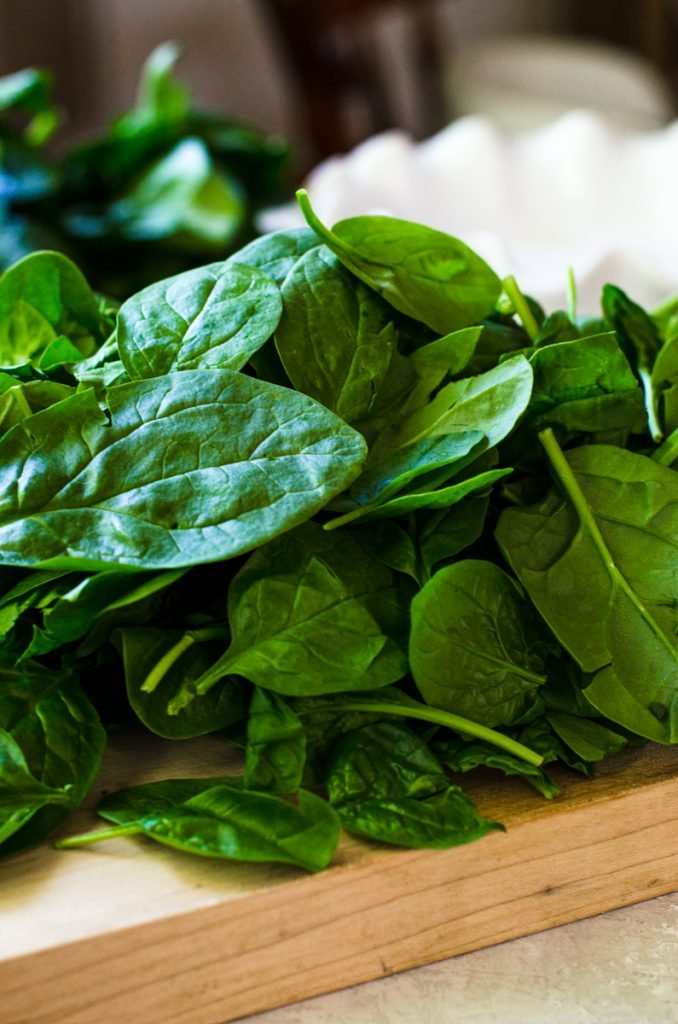 A cutting board of spinach