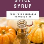 """A bottle of syrup with a purple block above it saying """"pumpkin spice syrup."""""""