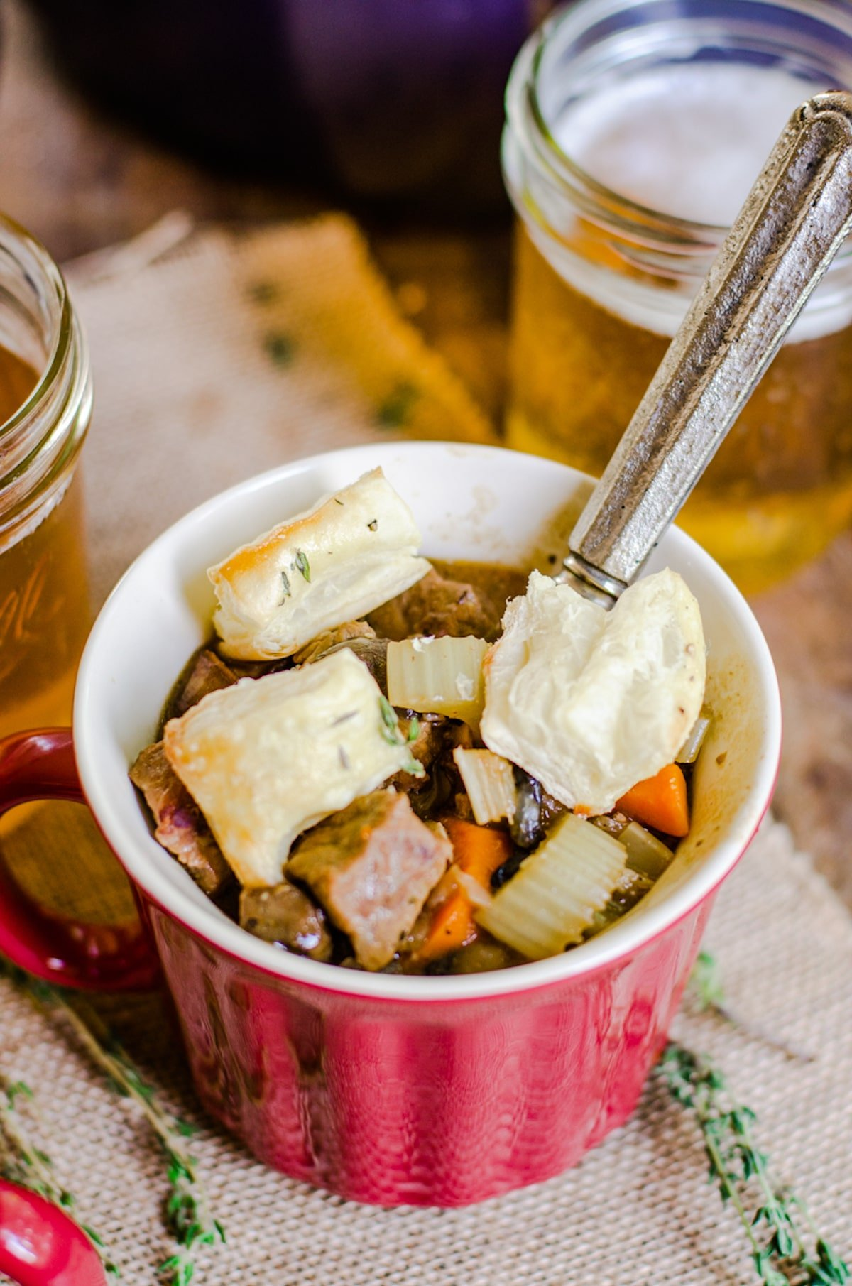 Inside of a mug of soup with puff pastry croutons.