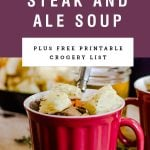 """A mug of soup with croutons and a purple block saying """"hearty steak and ale soup""""."""