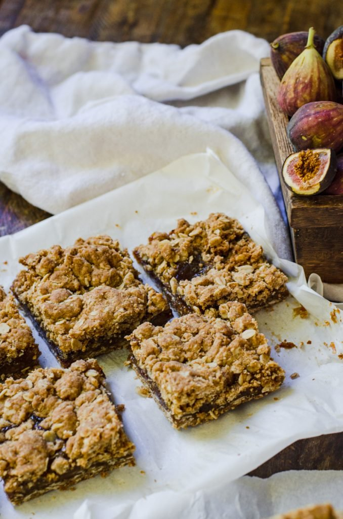 Cut homemade fig newtons bars on a piece of parchment paper.