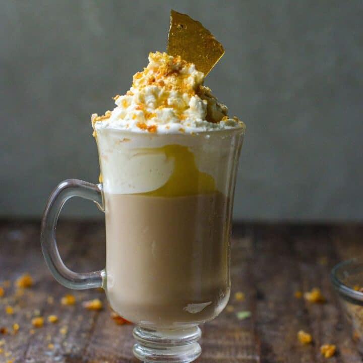 Homemade caramel brulee latte with bruleed sugar on top.