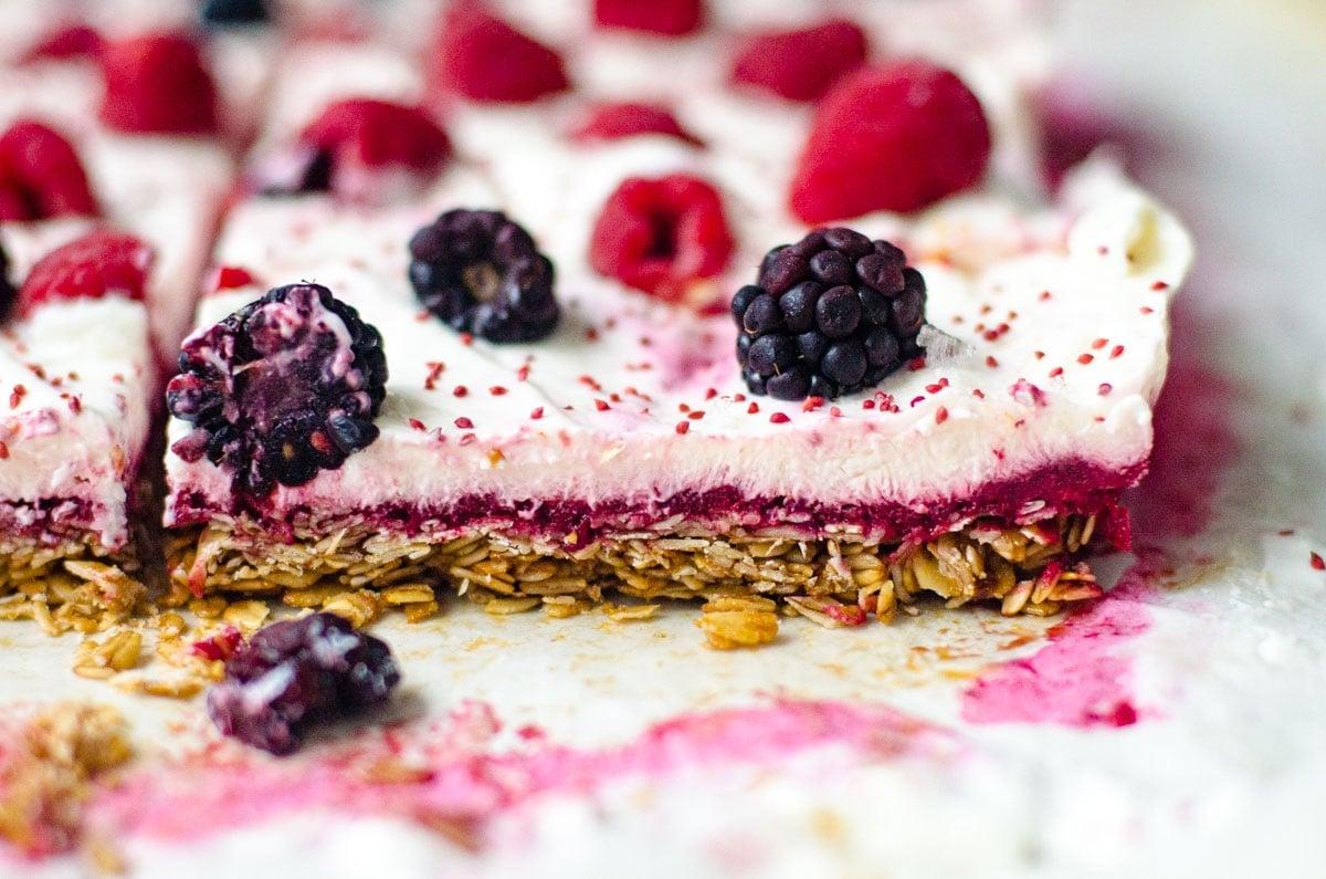 Close up of layers granola, berries, and yogurt.