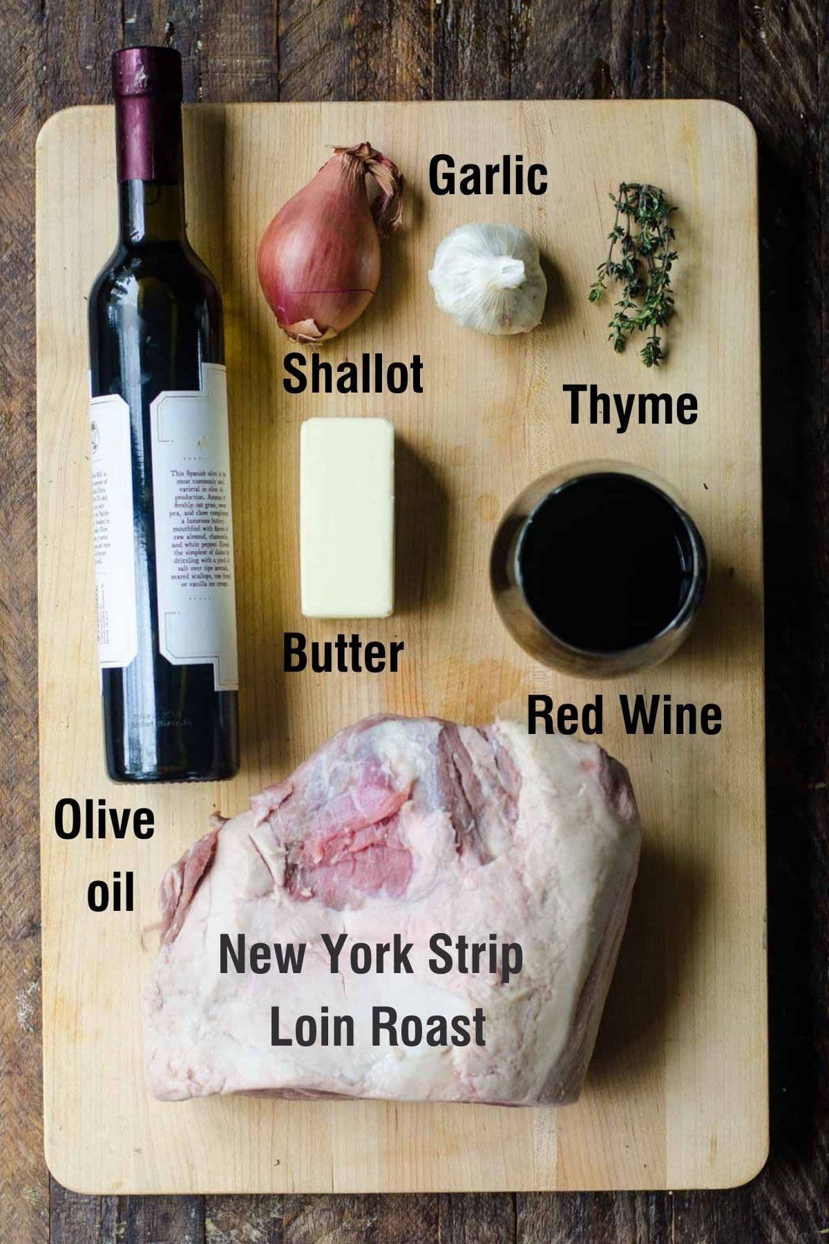 Ingredients on a cutting board for making new york strip roast.