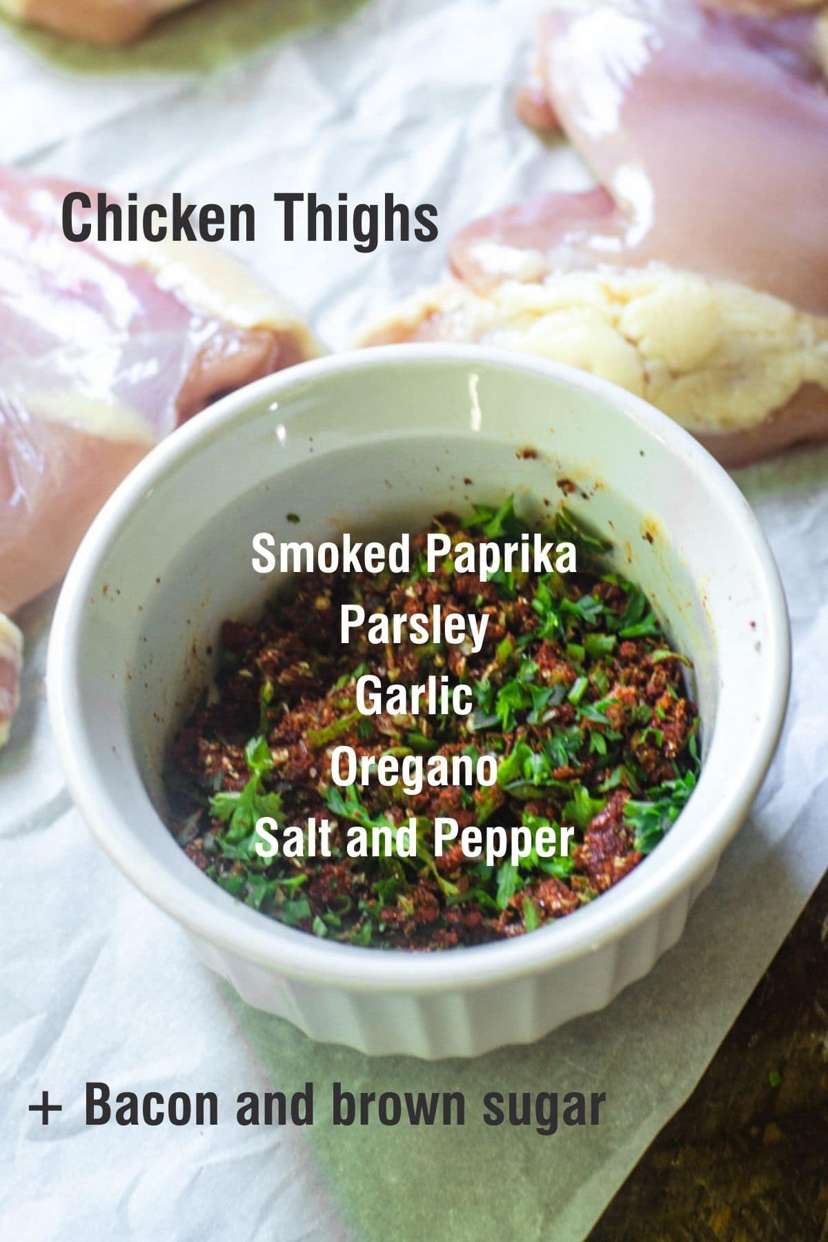 Photo of a ramekin next to raw chicken with text overlay of ingredients to make bacon wrapped chicken thighs.