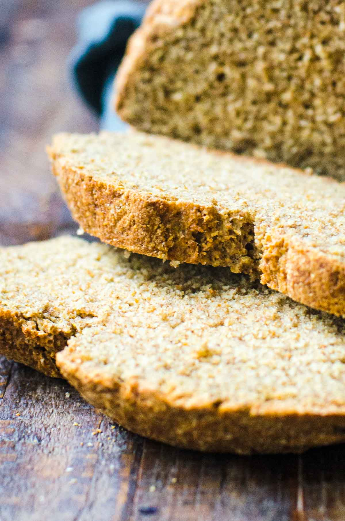 Close up of the crust of cut slices of soda bread.