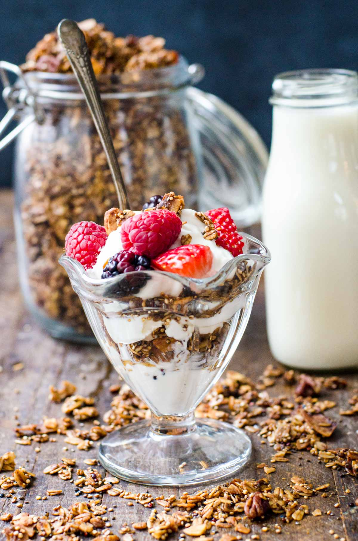 A yogurt and granola parfait topped with berries.