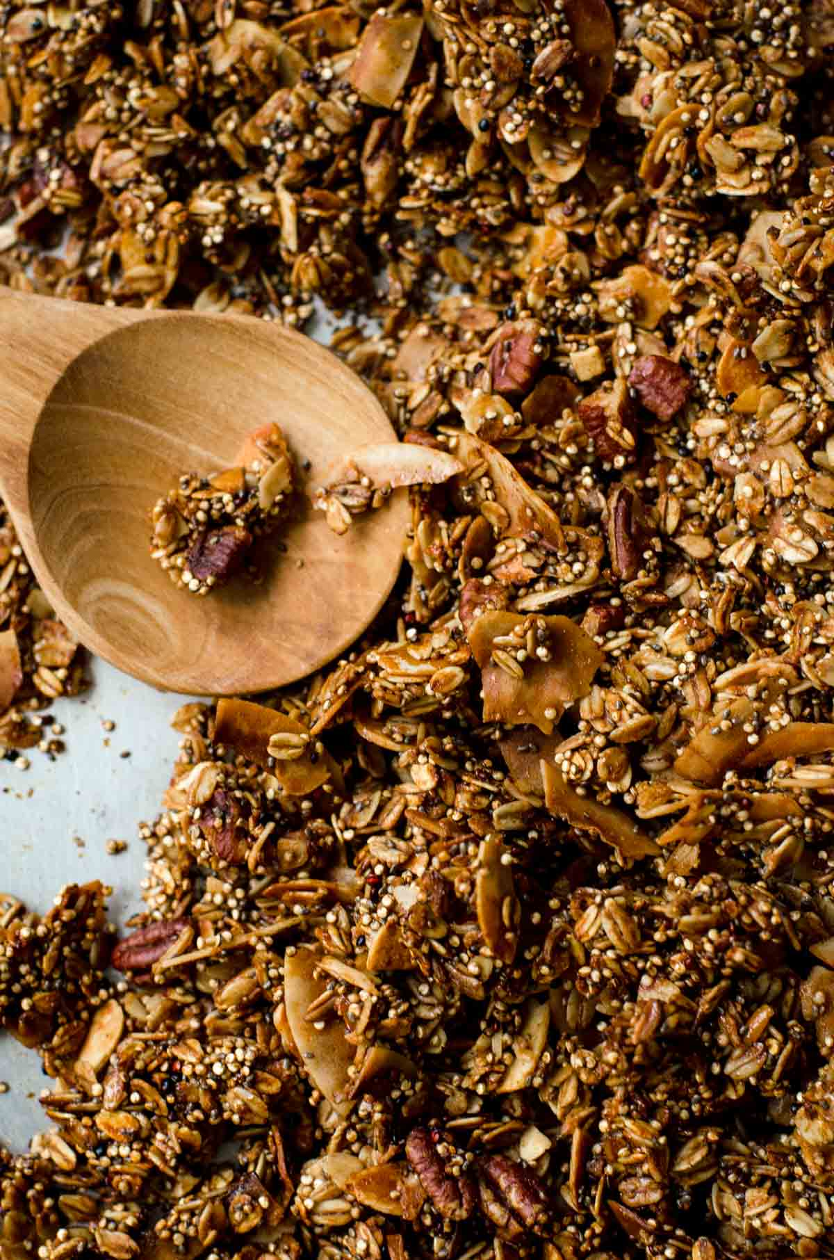 Close up of wooden spoon with granola.
