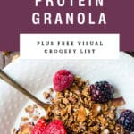 """A bowl of quinoa granola cereal with berries and a purple text box saying """"super high protein granola""""."""