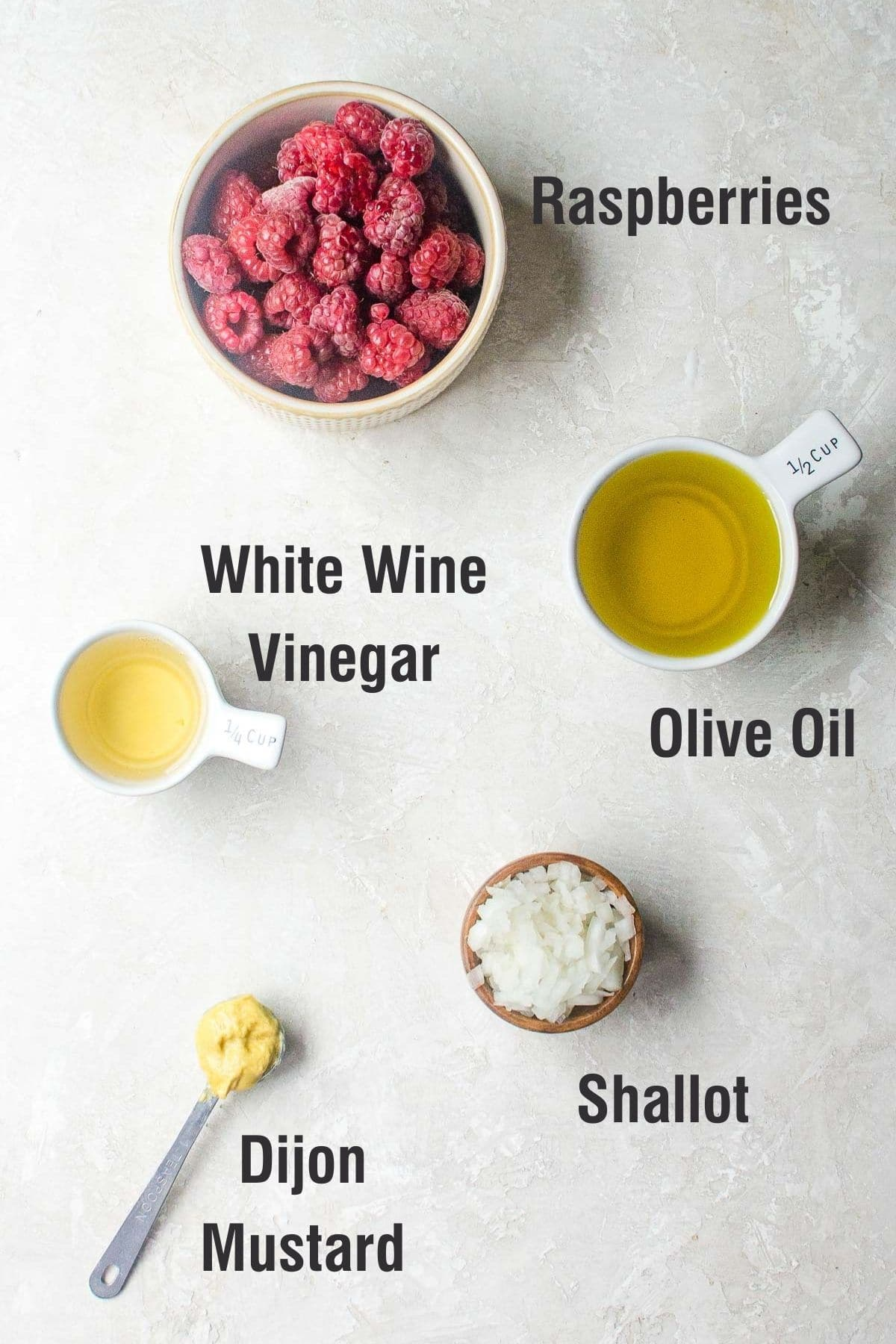 Labeled ingredients for making raspberry vinaigrette.