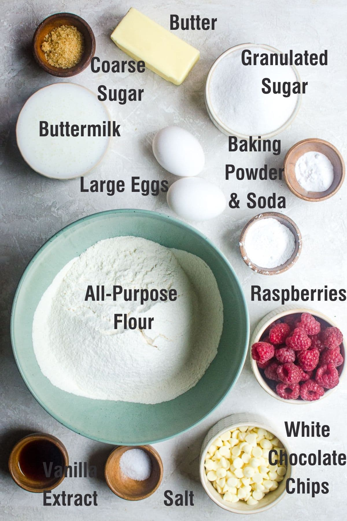 Labeled ingredients for making raspberry white chocolate chip muffins.