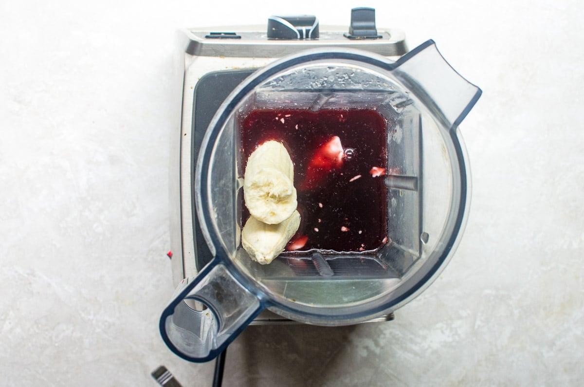 Banana, juice, and yogurt in a blender.